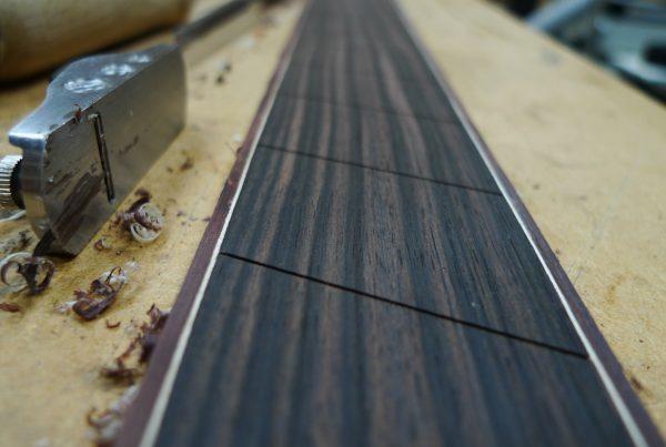 ebony fretboard, binding