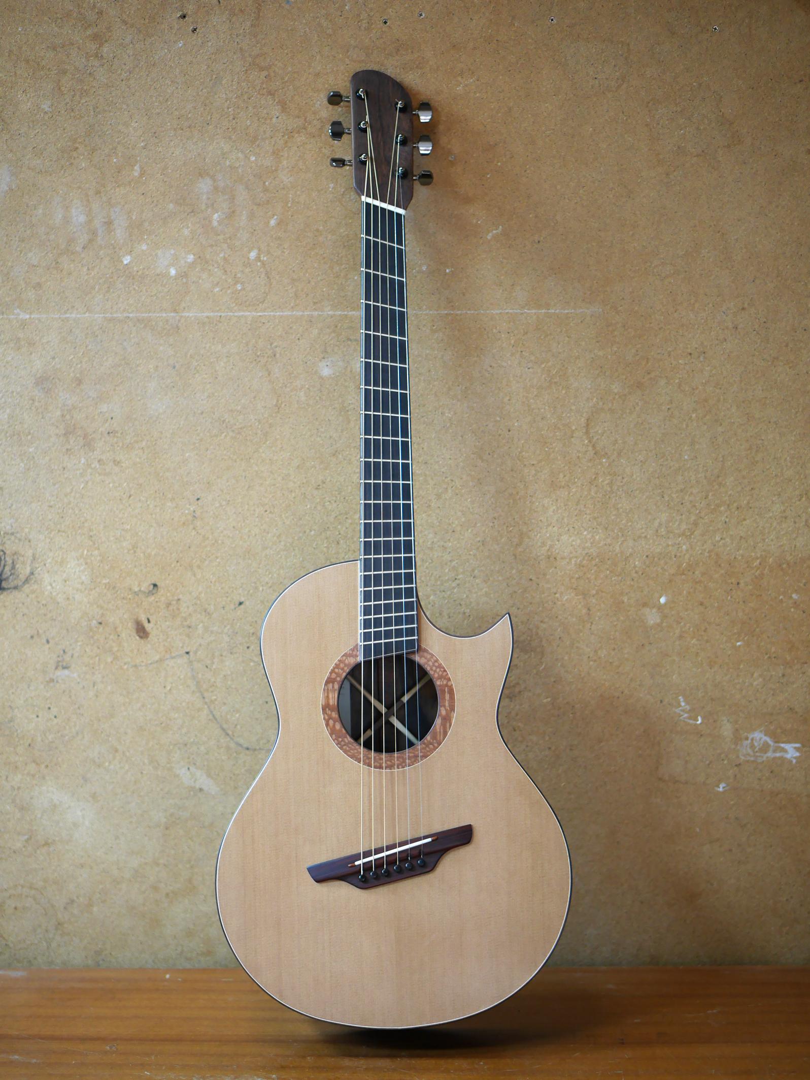 cedar guitar, fanned frets