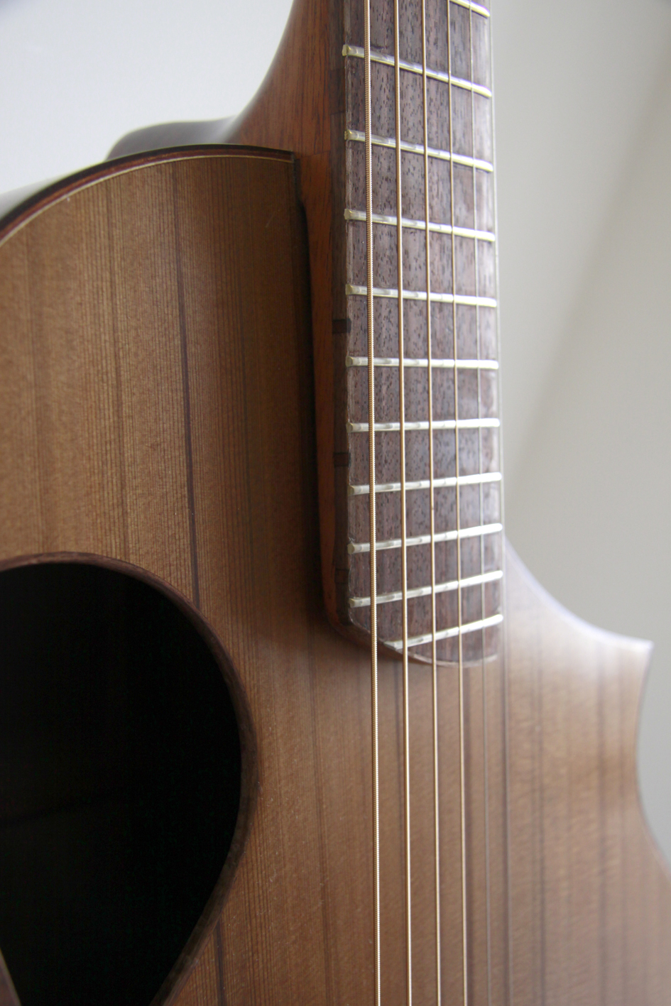 Cantilevered neck, montgomery guitars