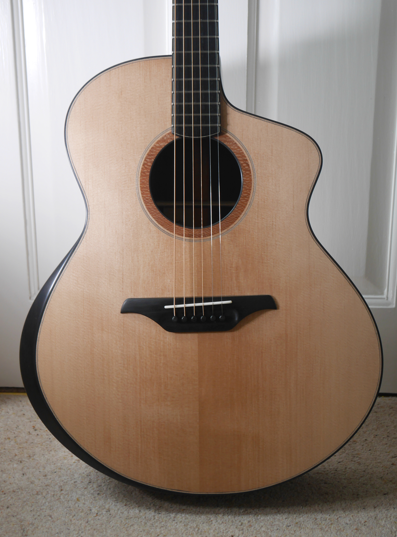 andreas montgomery, jumbo, bevel, acoustic guitar, handmade, montgomery guitars, luthier