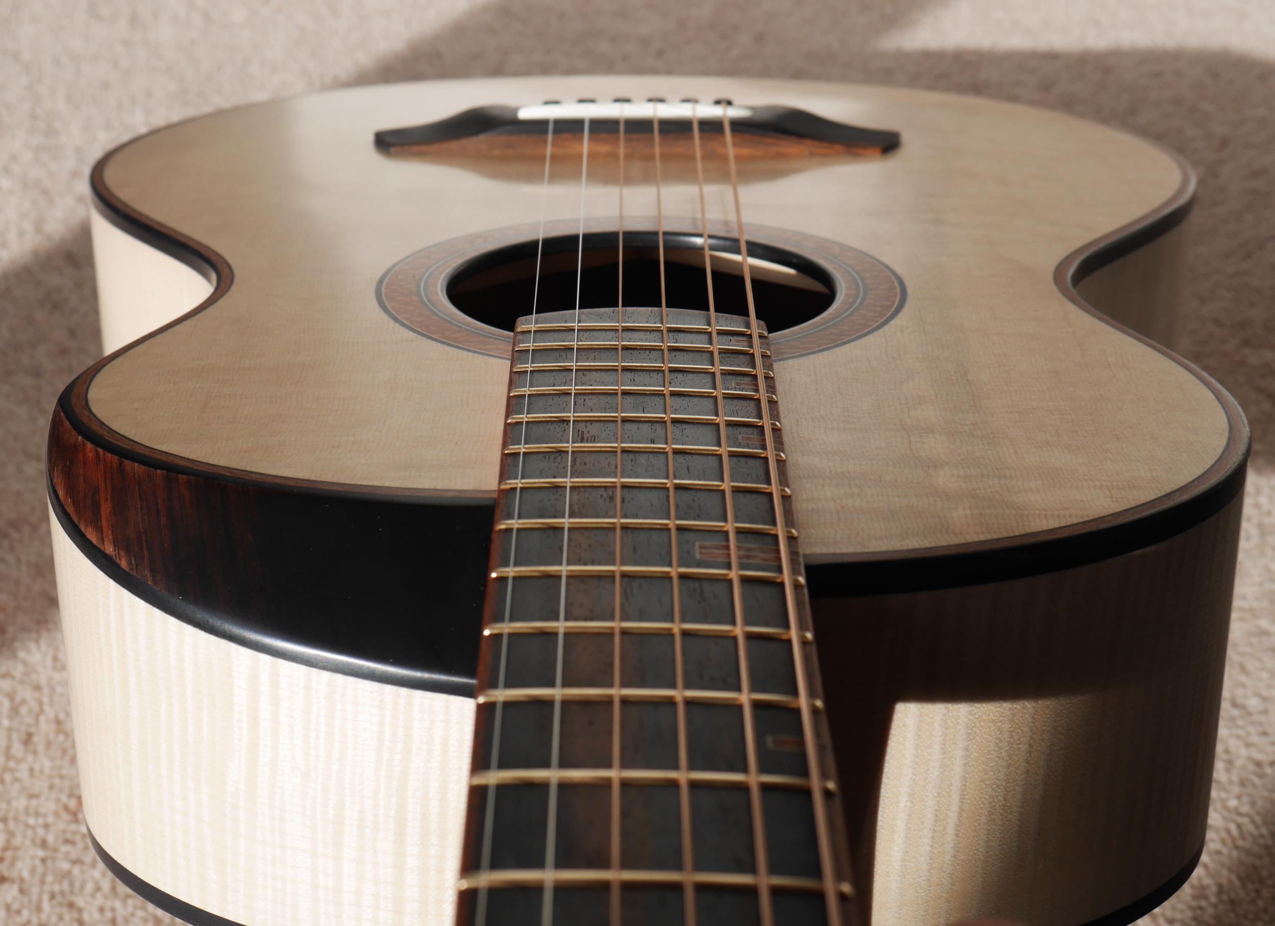 bevel guitar, flamed maple, bear claw spruce