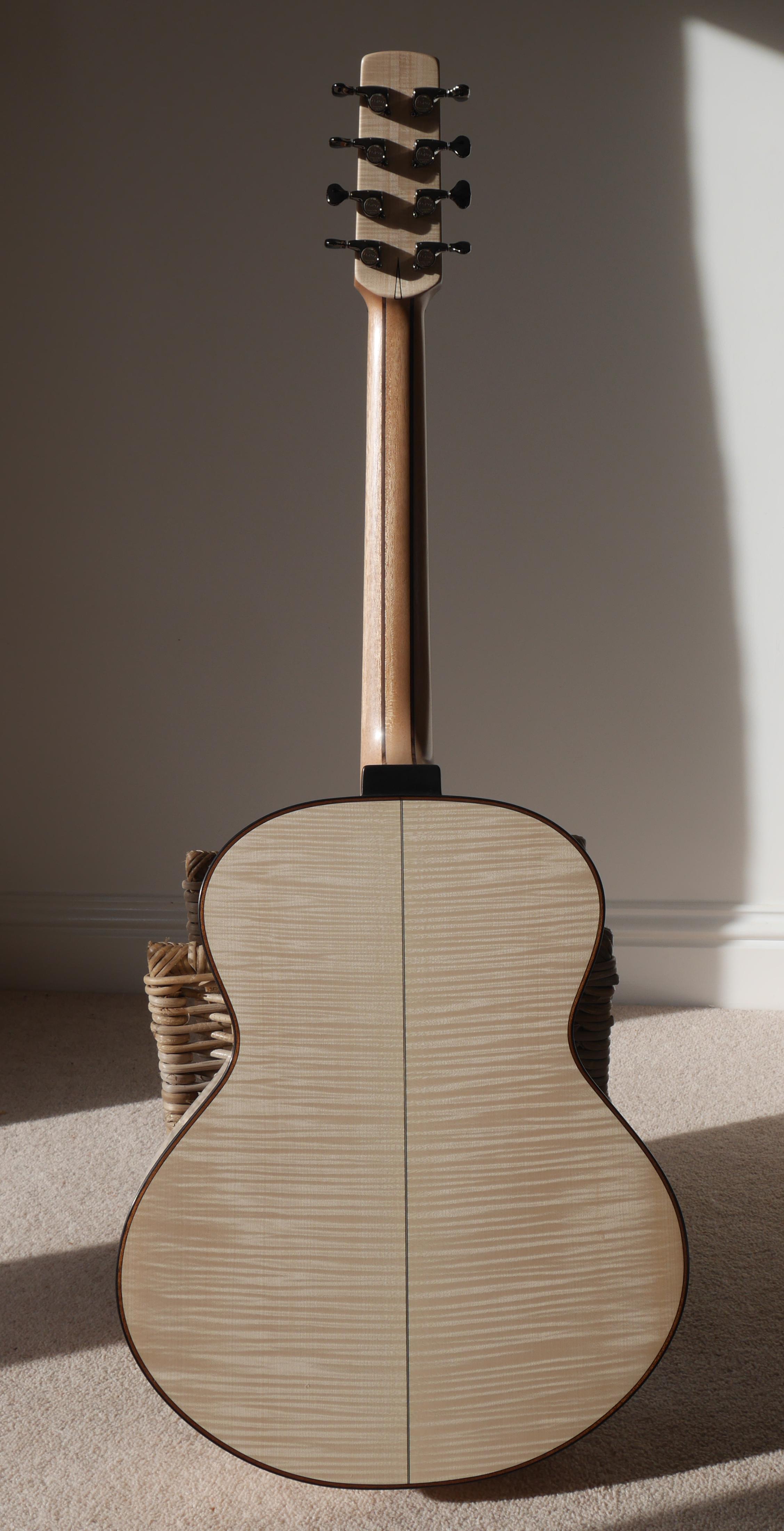 montgomery baritone, 8 string, acoustic guitar, montgomery guitar, andreas montgomery, flammed maple