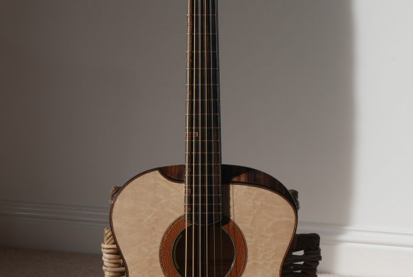 baritone guitar, made in Northern Ireland, carrickfergus, montgomery guitars. handmade, ebony, bear claw spruce, lacewood