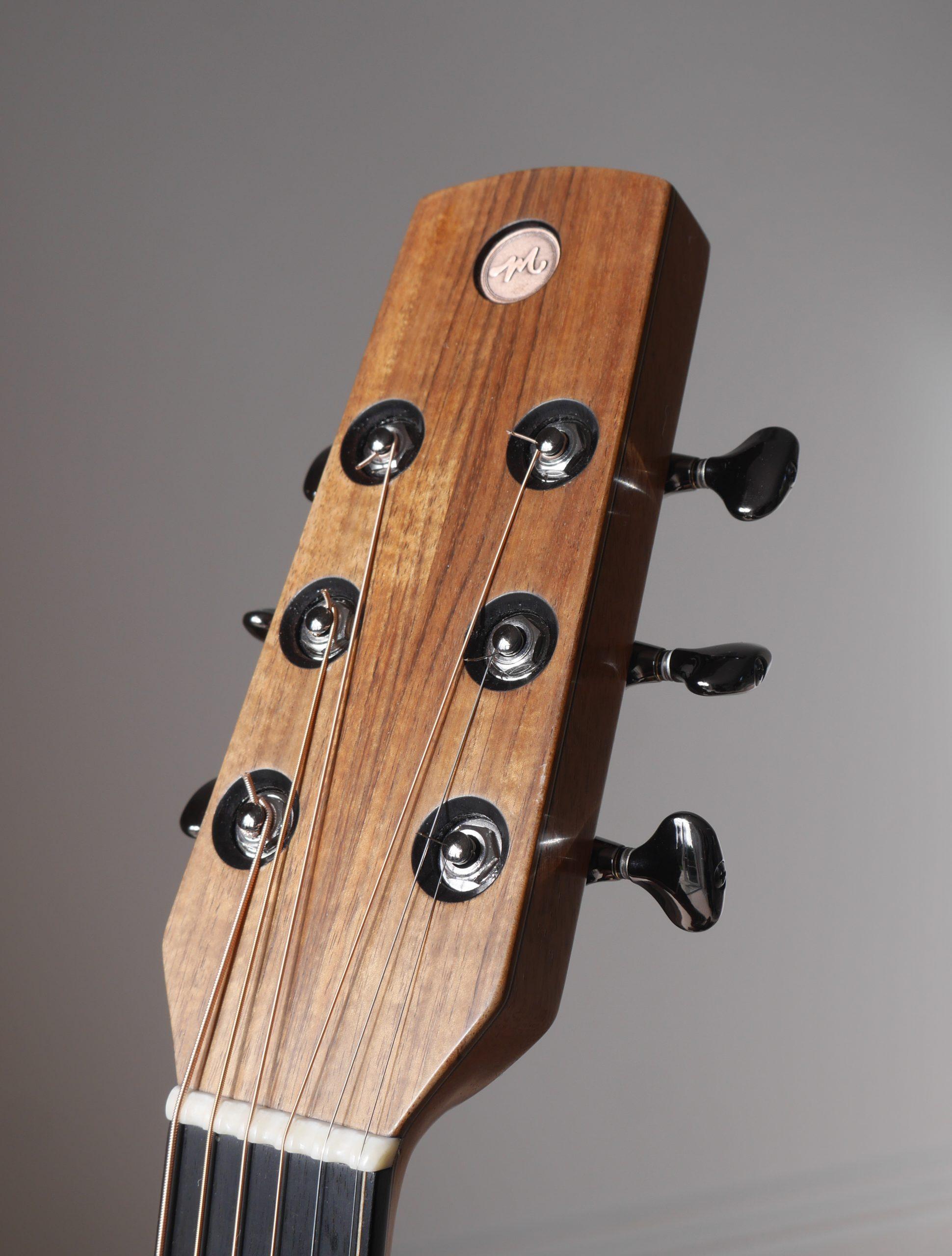 headstock, montgomery guitars, inlay, logo
